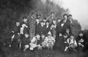Engineers with group of children, most likely in Germany