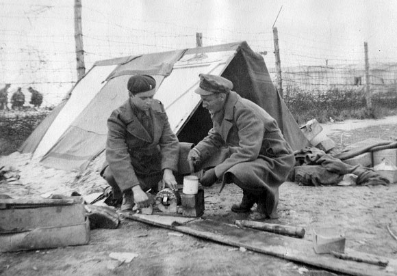 Jim Keeffe and Andy Anderson setting up a stove next to a tent