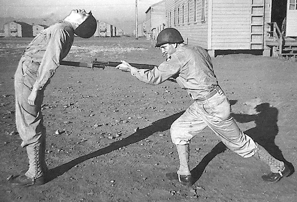In Camp White, Roy Welcnel with rifle clowning with Pvt Gilispy